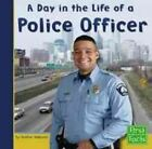 A Day in the Life of a Police Officer by Heather Adamson (Hardback, 2003)