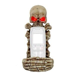 Schädel als Handyhalter, mit Knochen