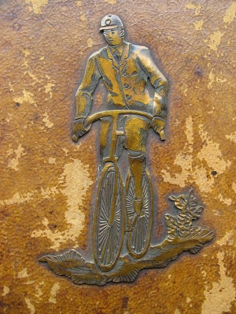 Antique leather covered wooden cigar box with copper antique cyclist cycling