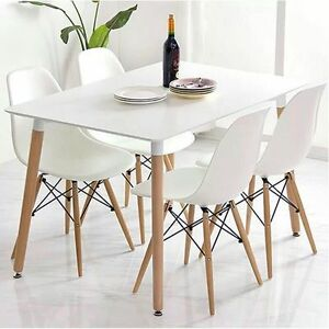 White Rectangle Dining Table And 4 Plastic Lounge Chairs