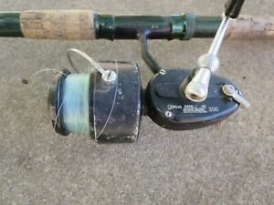 Vintage-Garcia-Mitchell-300-Spinning-Fishing-Reel-Made-in-France-w-Green-Rod