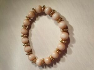 DUSKY-PINK-BEADED-ELASTICATED-BRACELET-WITH-GOLD-TONE-SPACERS