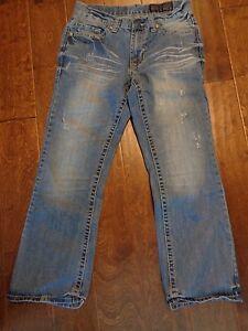 b67fb4d8d04 T.K. Axel Wolcott Mens Vintage Boot Cut Distress Wash Denim Jeans ...