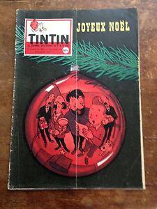 journal-tintin-582-France-1959-couv-Herge-avec-son-cheque-tintin-et-sa-creche