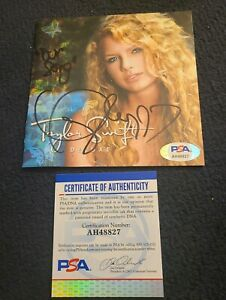 TAYLOR-SWIFT-SIGNED-TAYLOR-SWIFT-CD-COVER-DELUXE-OUR-SONG-PSA-DNA-AUTH-AH48827