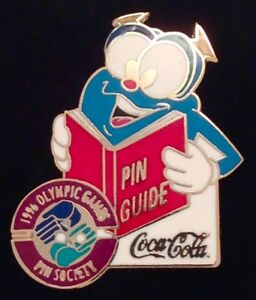 Official-Olympic-Pin-Guide-held-by-Izzy-Sponsor-Coca-Cola-Pin-Badge-1996-Atlanta