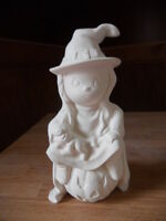 C-0857 Halloween Girl Witch Sitting On A Pumpkin Holding A Cat Ceramic Bisque