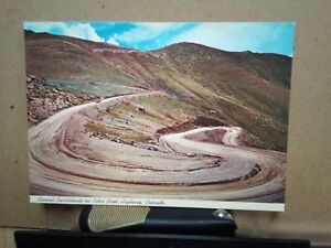 SEVERAL-SWITCHBACKS-ON-PIKES-PEAK-HIGHWAY-COLORADO-Cooper-Post-Card-IRELAND-1985