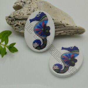 2-PZ-Ciondoli-Elemento-2-FORI-pendente-in-legno-con-disegno-CAVALLUCCIO-MARINO-2