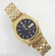 SEIKO Men's 7123-7060 Watch Gold Tone Steel Band Analog Black Dial Day Date