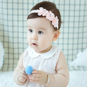 Image is loading 1PC-Delicate-Pearl-Flower-Headband-Baby-Elastic-Hairband- 80d2879c36b