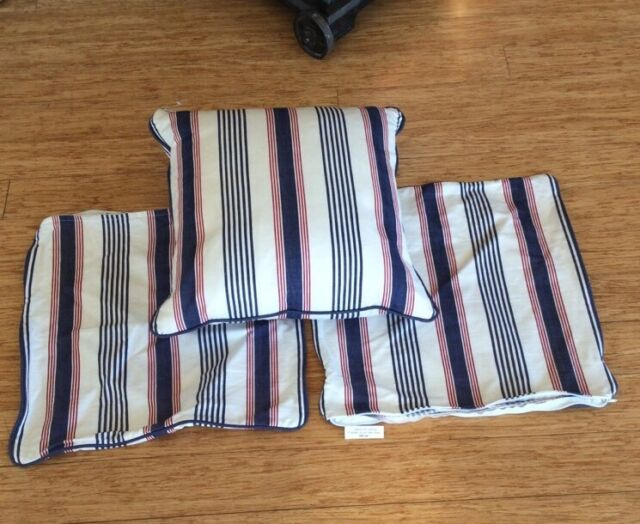 .SET OF THREE MATCHING CUSHION COVERS, IN THE STYLE OF RALPH LAUREN