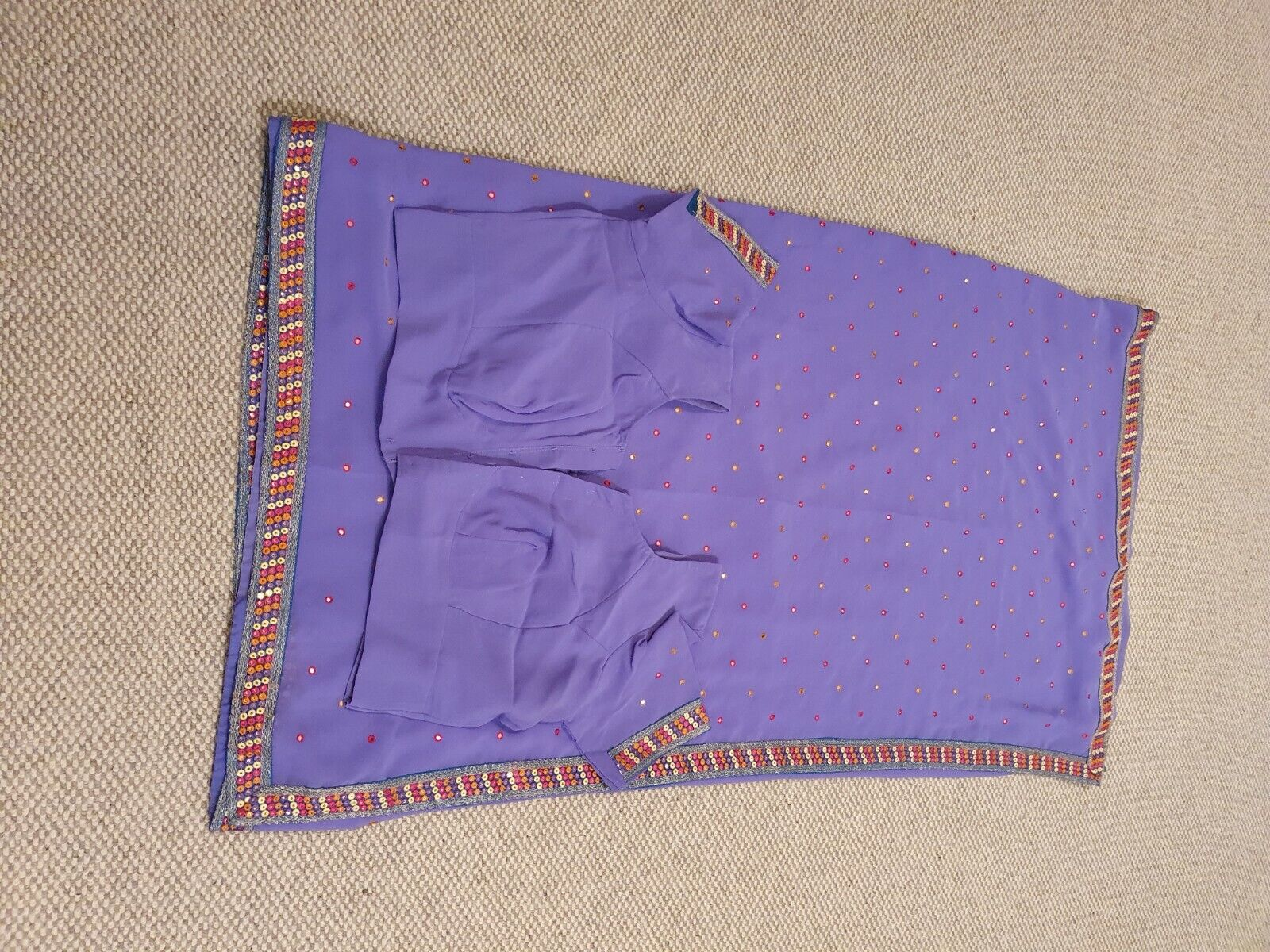 embroided saree in light purple with multi coloured stitching