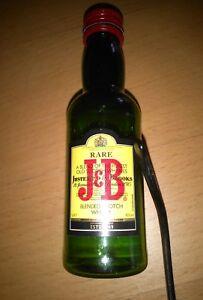 botellita-J-B-rare-Whisky-vacia