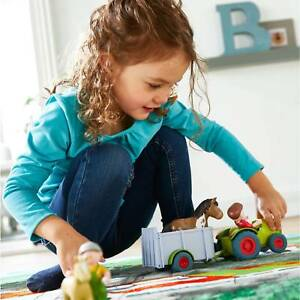 Haba 303131 Little Friends Kleinkindspielzeug Traktor mit Anhänger Puppe