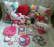 Hello kitty lot  plush, toys, charms, plate, make up bag container, dvds and tin