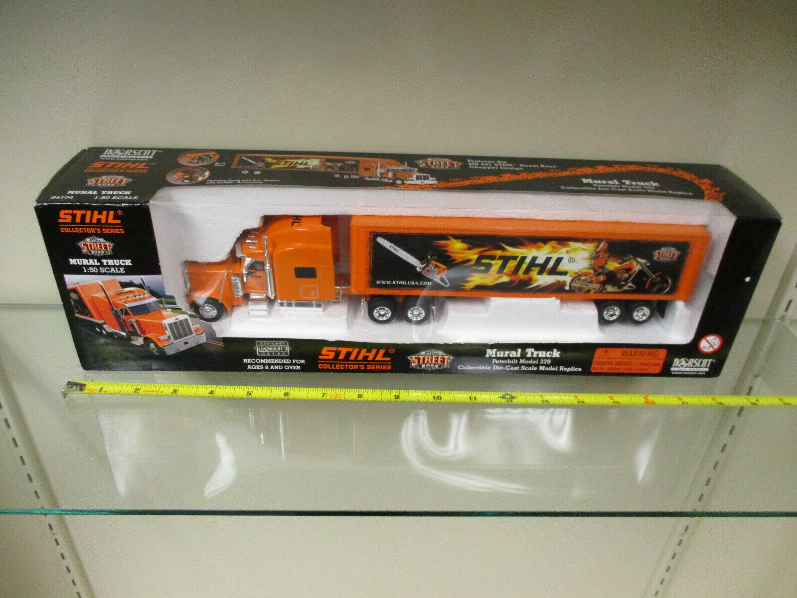 STIHL CHAINSAW Street Boss Peterbilt Semi con remolque por Norscot Escala 1 50th