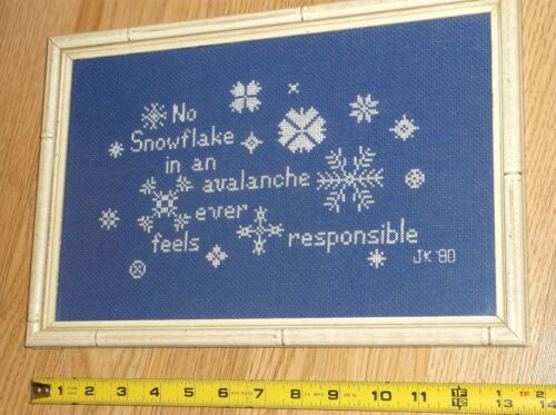 'NO SNOWFLAKE IN AN AVALANCHE EVER FEELS RESPONSIBLE' JK'80 FRAMED CROSS STITCH