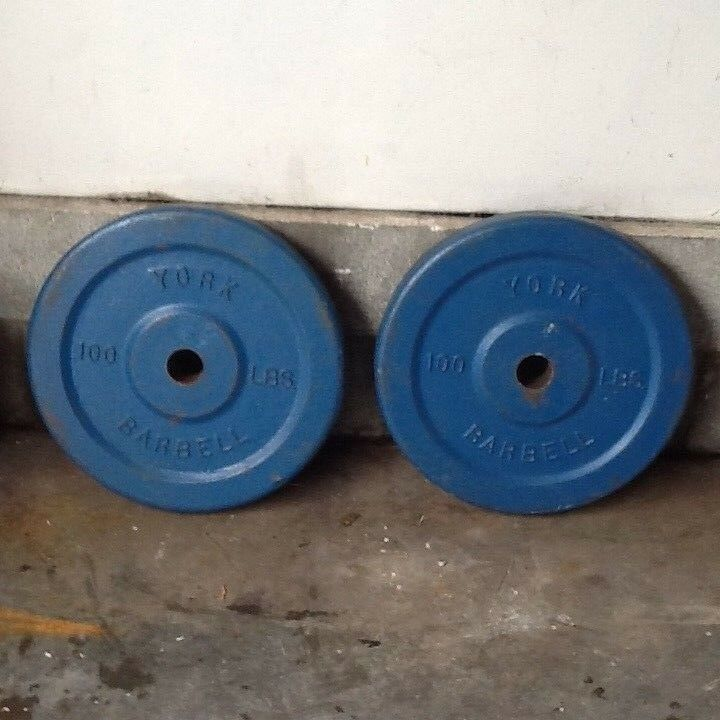TWO VINTAGE YORK 100 POUND BARBELL OLYMPIC 2  DOUBLE FACED WEIGHT PLATES