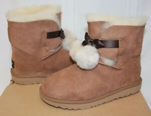 5d4a39fe39e Details about Ugg Kids Gita Pom Pom chestnut suede boots 1017403K NEW With  Box