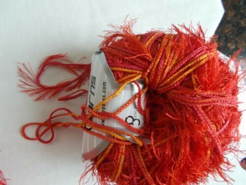 109 yds each red//orange lot of 2 Eyelash Magician polyester yarn