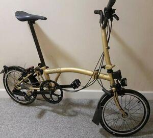 Brompton Pieghevole Prezzi.Dettagli Su Brompton M3l Gold Sparkle Black Edition Custom Pieghevole Bici 38 Uk Ampia P P Mostra Il Titolo Originale