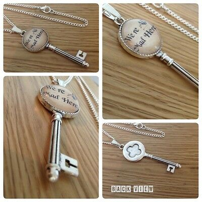 Alice in Wonderland we are we're all mad here mad hatter key necklace