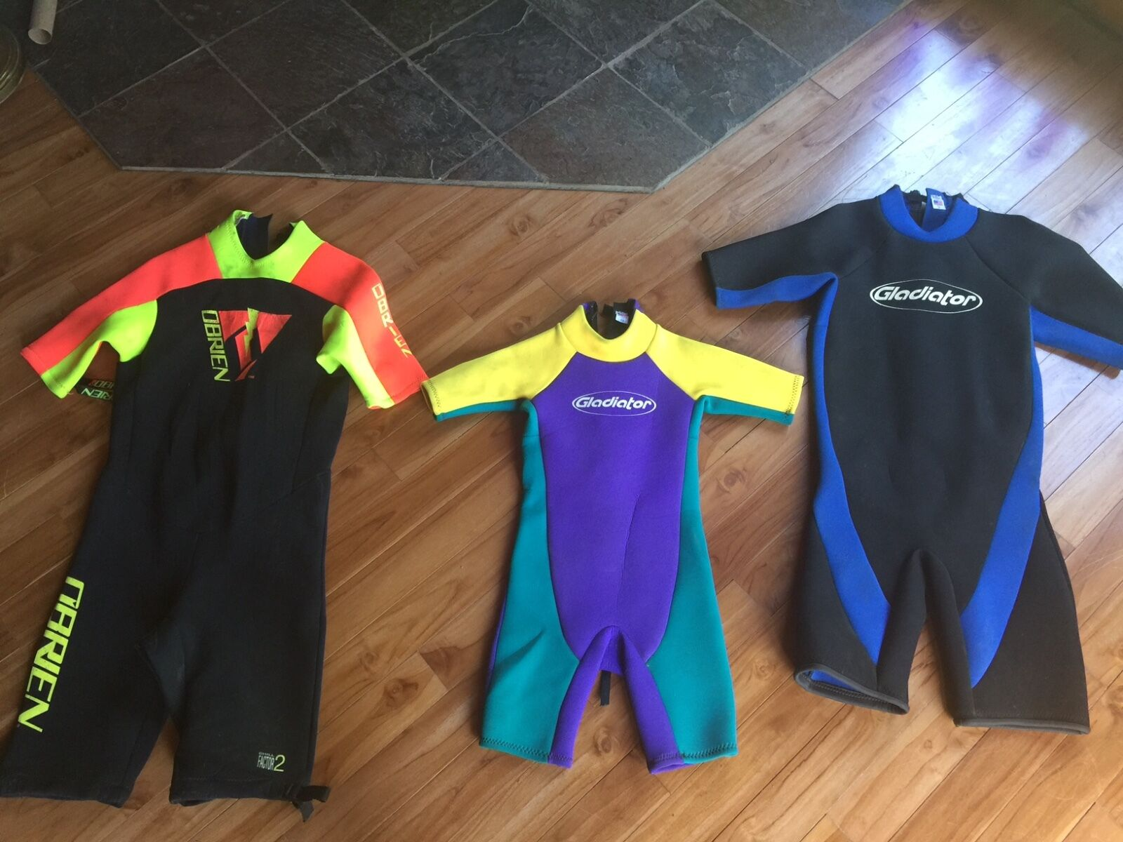 Three Shorty Wetsuits   O'Brien (size large), Gladiator (large and 12)