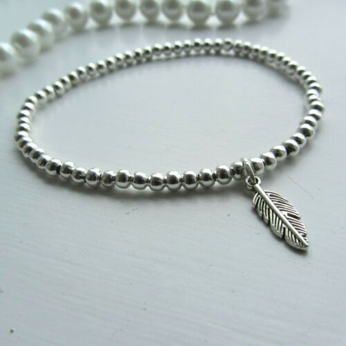 Silver ball stretch wish bracelet lucky mini feather charm perfect stacker gift