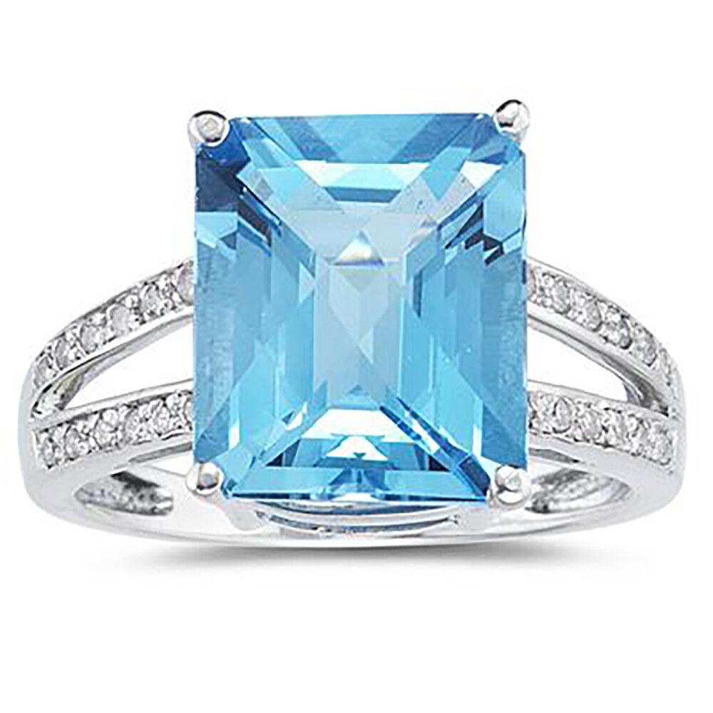 7 Carat Emerald  Cut bluee Topaz and Diamond Ring 10k White gold