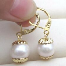 a Pair of Natural 10-11mm South Seas White Pearl Earrings 14k