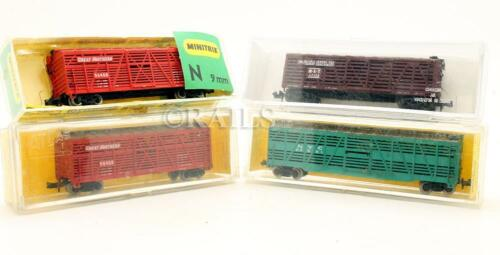 VARIOUS MAKES 'N' GAUGE RAKE OF 4 ASSORTED CATTLE WAGONS 11D