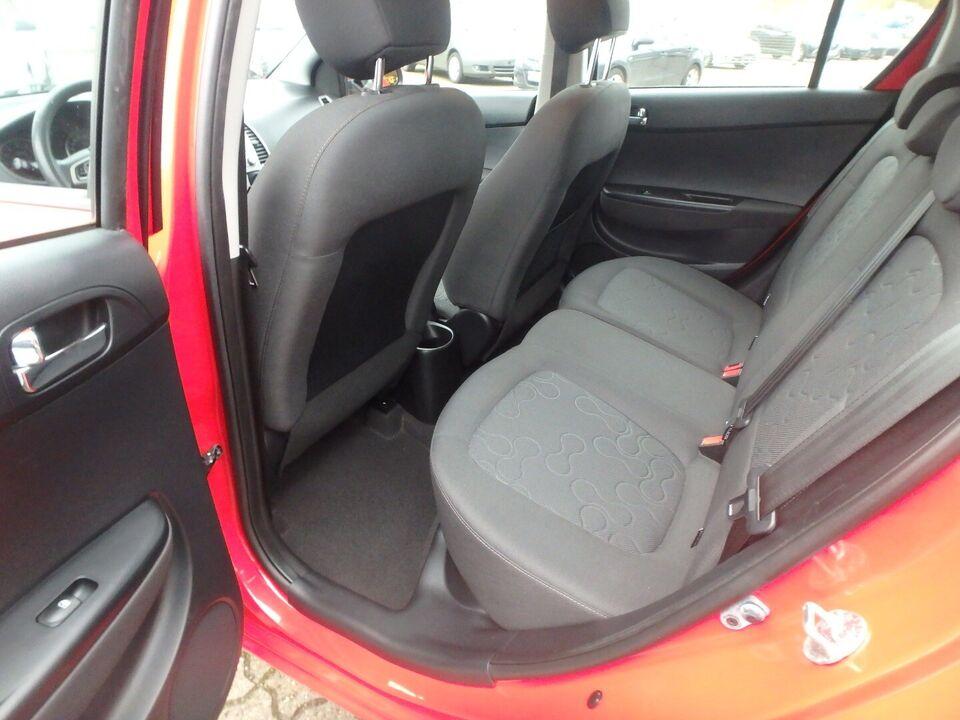 Hyundai i20 1,25 Comfort Benzin modelår 2011 km 276000 Rød