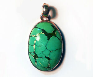 Silver and turquoise pendants, handcrafted in India