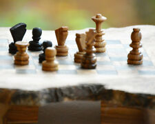 A handcrafted Chess board S, made of olive wood with drawers and small bracket