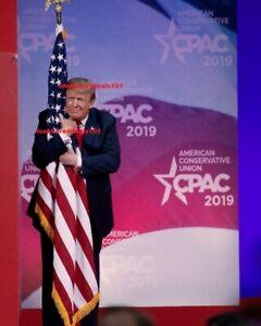 "8x10"" PHOTO DONALD TRUMP HUGGING THE AMERICAN FLAG"