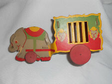 Antique Cardboard circus wagon and elephant Toy