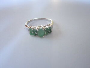 Stylish-9-Stone-Sterling-Silver-Emerald-Ring-with-oval-and-round-stones-size-8
