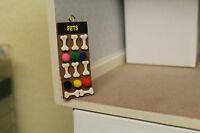 Dolls House ( Pet Shop Hanging Board = Dog Bones & Balls