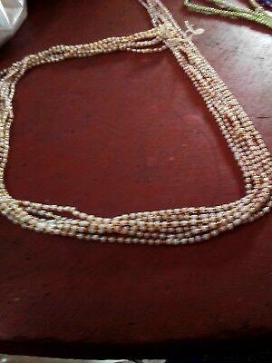 portée en Afrique de l/'Ouest Parure-ceinture de reins 6 brins de perles.