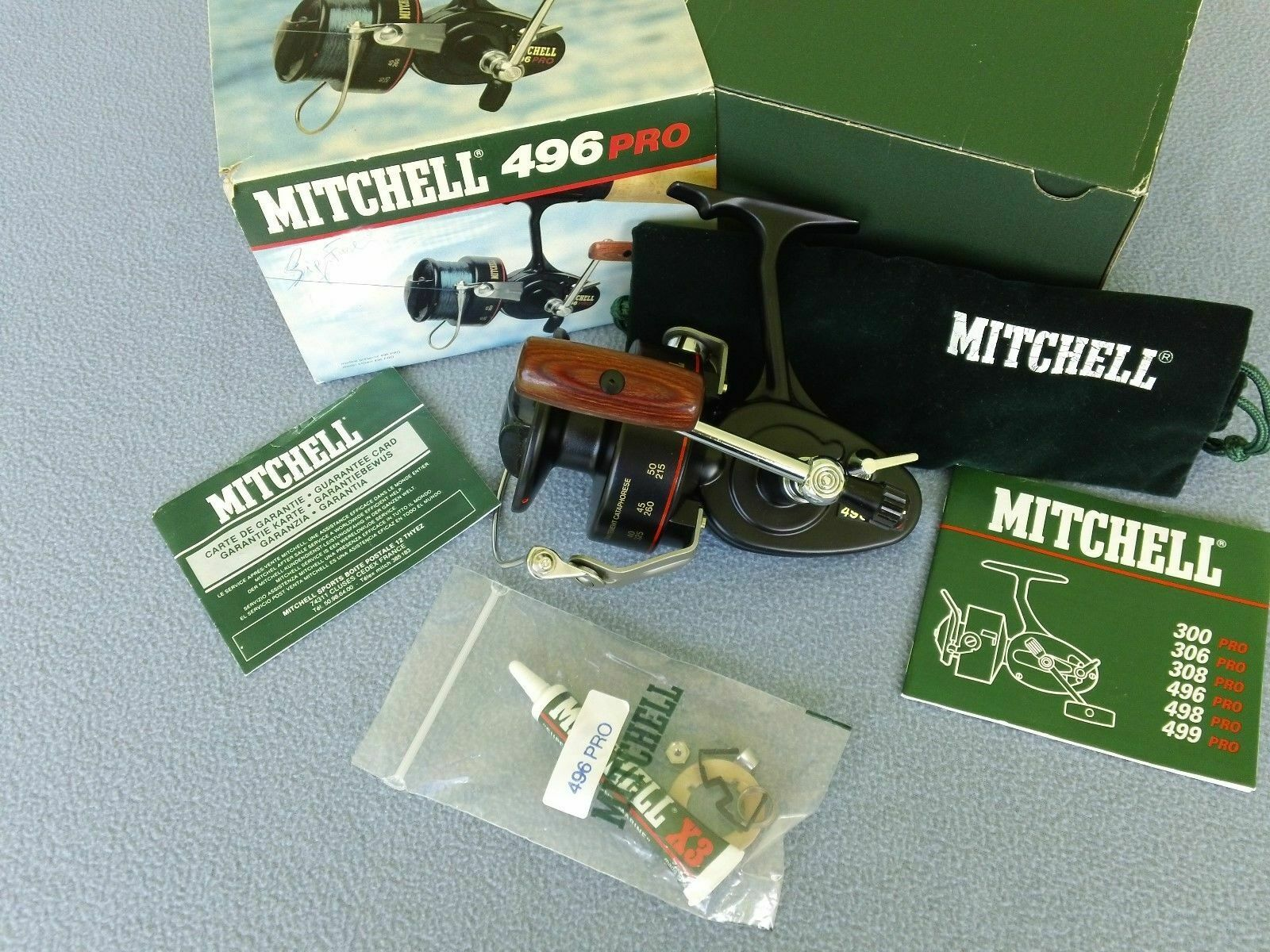 RARE VINTAGE MITCHELL 496  PRO SPINNING REEL -  MINT NOS COMPLETE IN THE BOX  great selection & quick delivery