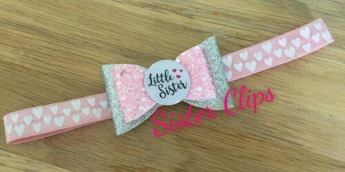 Baby 0-3 months glitter white little sister bow on pink heart Elastic headband
