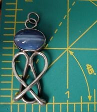 Sterling Silver Wire Wrapped Blue Cabochon Stone With Two Strip Sculpted Pendant