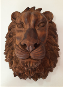 Hand carved hand made lion face