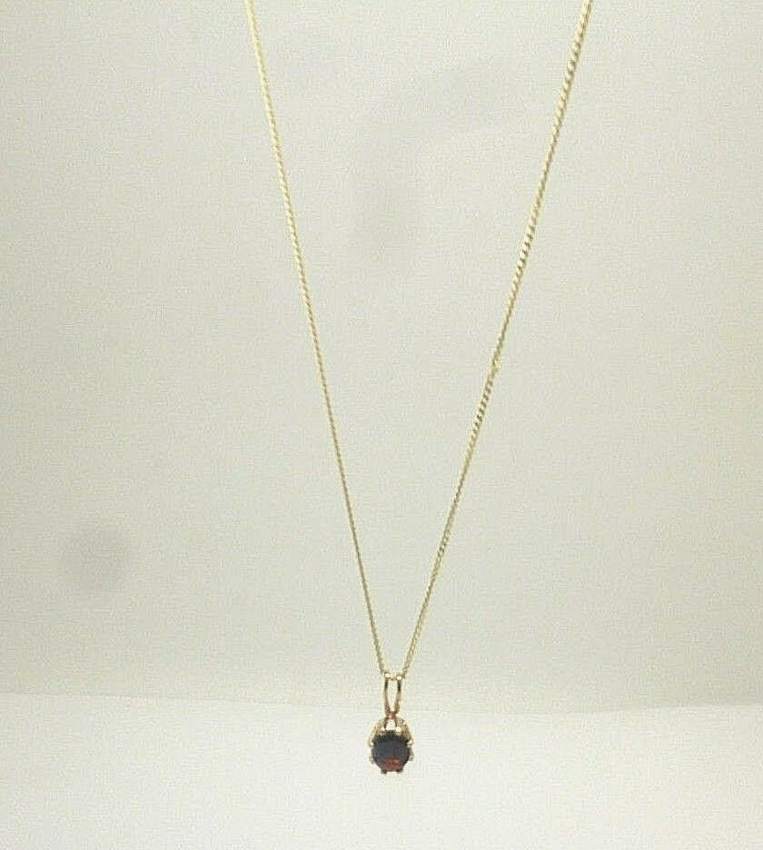 9ct yellow gold oval cut claw set garnet pendant with 18' curb chain