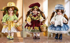 SEASONAL 12 INCH BISQUE DOLL WITH THREE OUTFITS COA