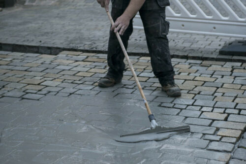 Spread grout mortar slurry into joints. Paving Squeegee with wooden handle