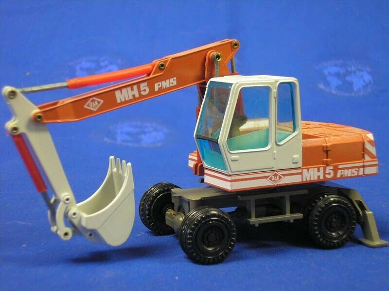 NZG 333-1 O&K MH5 PMS Wheel Excavator - Die-cast 1 50 MIB