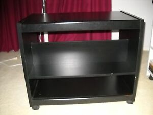 Black tv stand or microwave cart on wheels