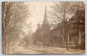 Newport-Pennsylvania-Main-Residential-Street-Homes-Churches-Wagons-1909-RPPC